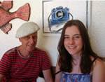 Aiden and Mariana, at home, with their artwork on the walls of the terrace
