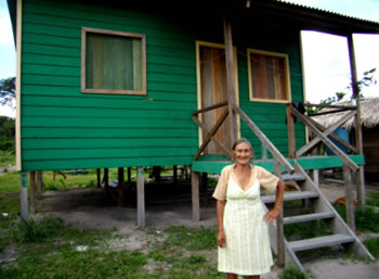 Old lady gets a wooden-home from Government in the pristine forestOld lady gets a wooden-home from Government in the pristine forest