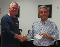 Honeyguide Wildlife Holidays leader Rob Macklin (left) with Domingos Leitão, both Honeyguide leader and SPEA officer, accepting the Honeyguide Wildlife Charitable Trust cheque for €1000 (about £763)