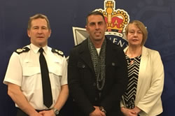 Freddie (centre) with the Deputy Chief Constable Julian Williams of Heddlu Gwent and Detective Sergeant Gaynor Hart