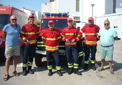 Steve Scott (left), Ian Bedford (right), Fire Chief Mario Costa (third from left)