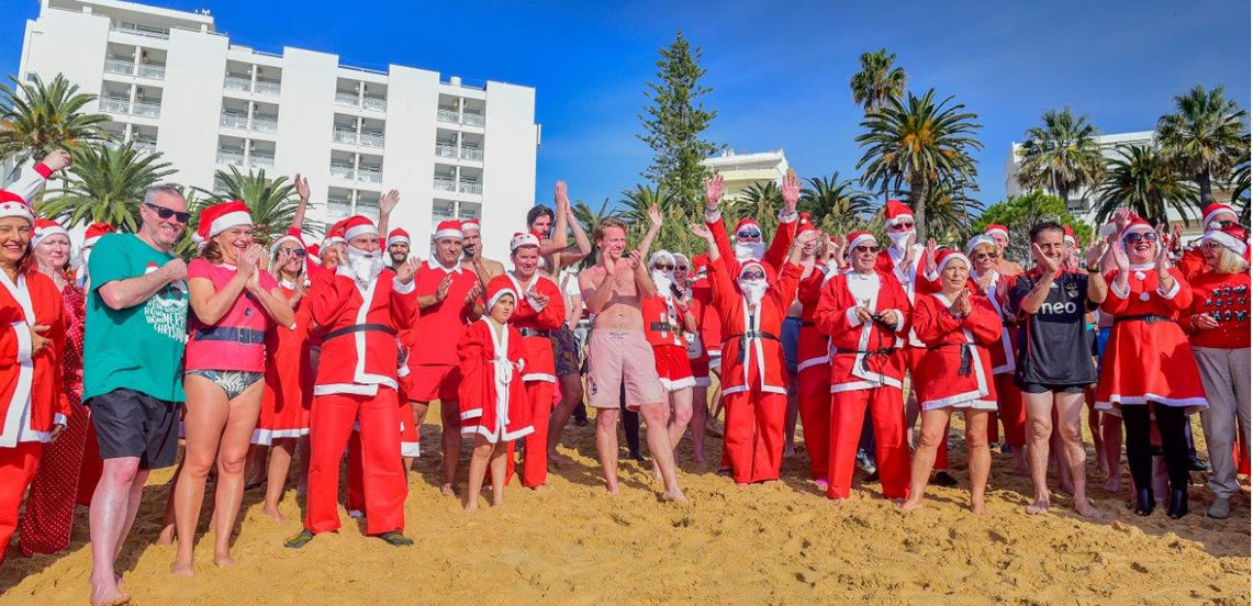 Blue skies and warm sea for the charity Santa Swim 2018